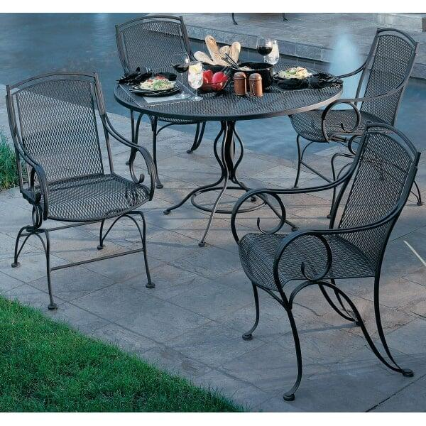 Modesto outdoor patio dining set by woodard outdoor for Wrought iron dining set outdoor